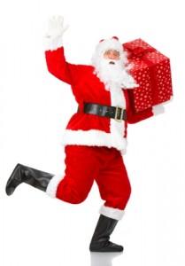 Jultomten springer med julklapp